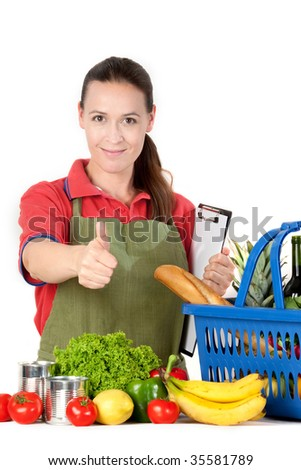 A young friendly grocery store assistant with a clipboard. - stock photo