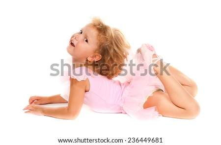 A young girl ballet dancer in a pink lace tutu. Isolated on white background. - stock photo