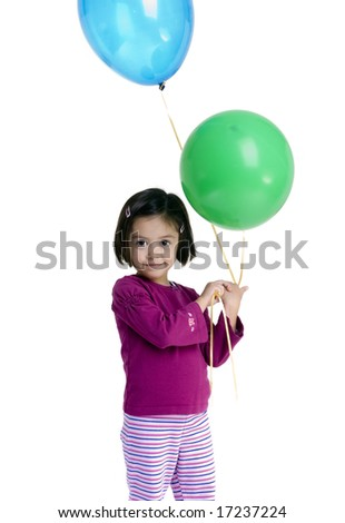 A young girl celebrates a birthday party. - stock photo