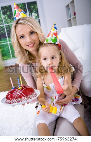 a young girl celebrating birthday