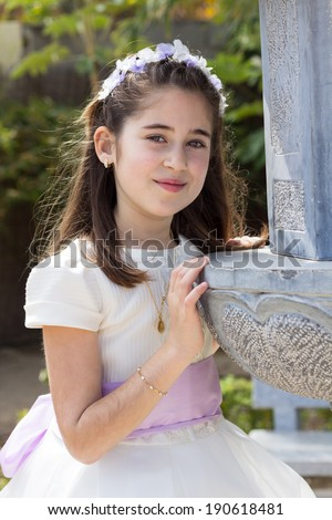 A young girl celebrating her First Holy Communion - stock photo