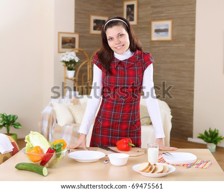 a young girl cooking  healthy food at home