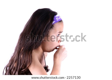 A young girl coughing, against white background with copy space. - stock photo