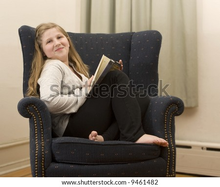 a young girl curling up with a good book