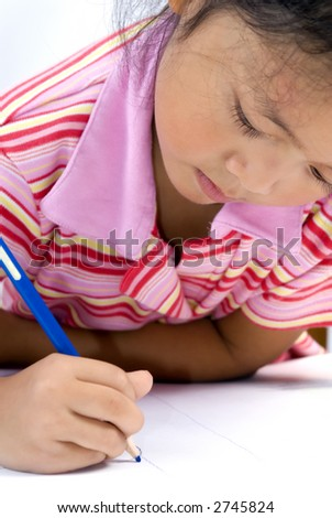 A young girl draws a picture. Education, childhood