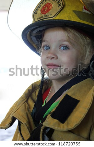 a Young girl dressed as a firefighter - stock photo