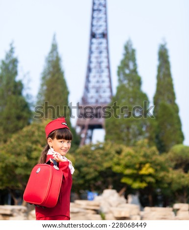 A young girl dressed as a flight attendant sees the sights. - stock photo