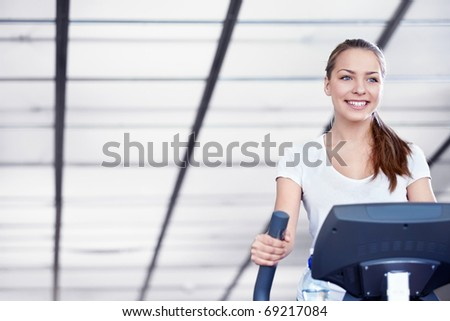 A young girl engaged in fitness - stock photo
