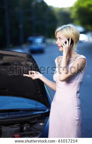 A young girl explains on the phone about car breakdown - stock photo