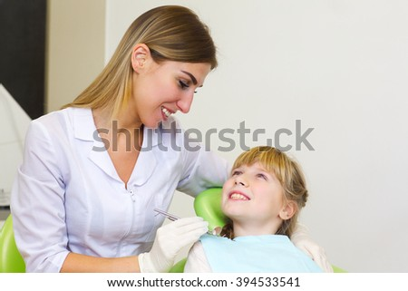 A young girl getting her dental checkup at the dentist.Dentist