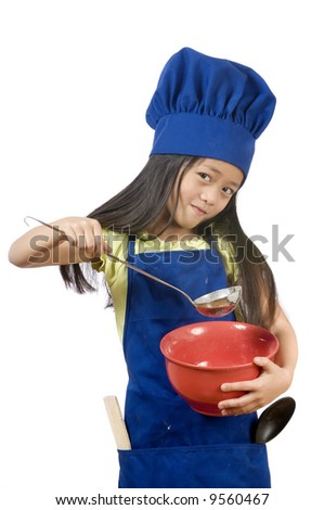 A young girl having fun in the kitchen making a mess....I mean making cookies. - stock photo