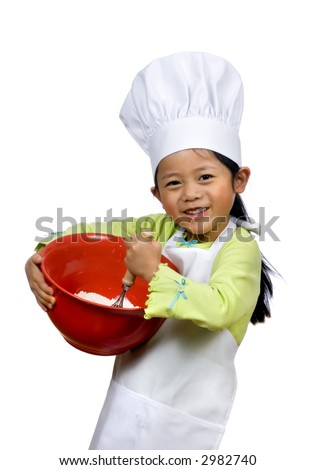A young girl having fun in the kitchen making a mess....I mean making cookies. Education, learning, cooking, childhood