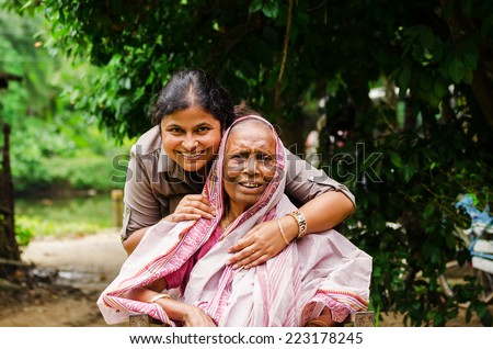 A young girl helping an old Lady. - stock photo