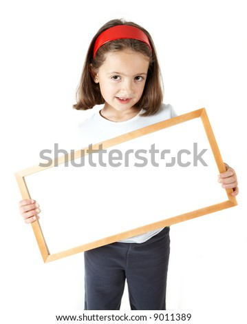 A young girl holding a blank white board isolated on white background