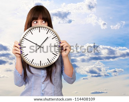 A Young Girl Holding A Clock, Outdoor - stock photo