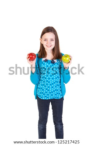 a young girl holding a delicious red and green apple