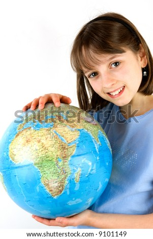 A young girl holding a globe against white