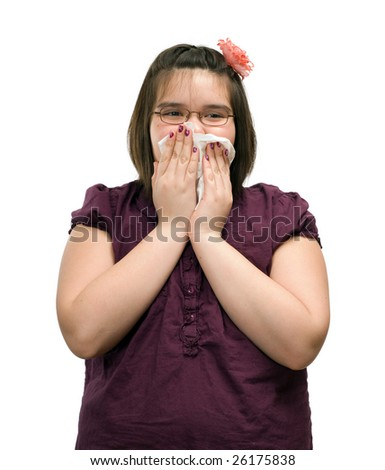 A young girl holding a tissue to her mouth while she is coughing, isolated against a white background - stock photo