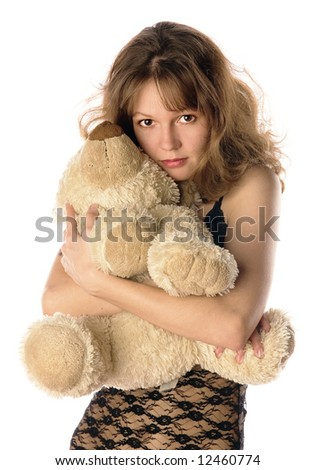 A young girl holding her teddybear isolated on white background - stock photo