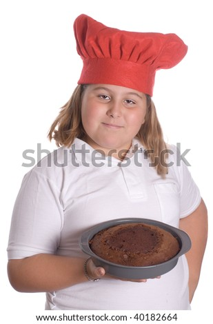A young girl holding up a brown cake that she baked, isolated against a white background - stock photo