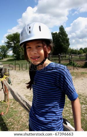 a young girl horseback riding - stock photo