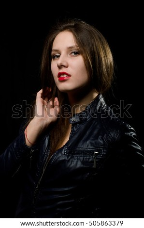 a young girl in a leather jacket