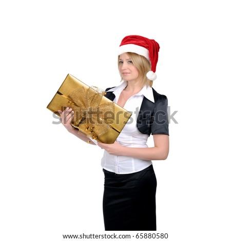 A young girl in a Santa hat and with a gift in their hands. Symbol of a successful business in the new year. Happy New Year and Merry Christmas! - stock photo