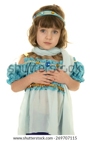 A young girl in her costume with a serious expression on her face. - stock photo