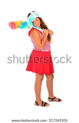 A young girl in red is holding a dust brush - stock photo