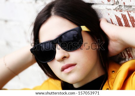 A young girl in sunglasses - stock photo