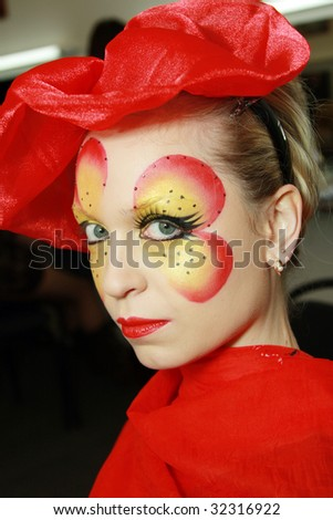 A young girl in the studio make-up - stock photo