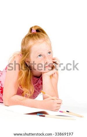 A young girl is concentrating of what to write next - stock photo