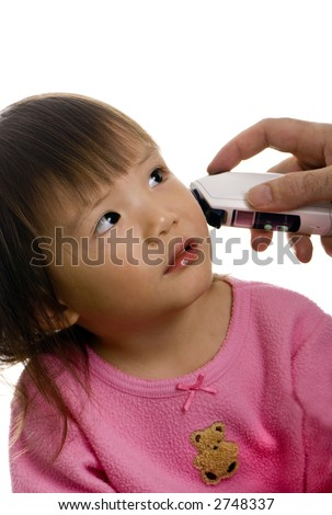 A young girl is sick and has her temperature taken as she looks at her father. - stock photo