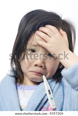 A young girl is sick and having her temperature taken. - stock photo
