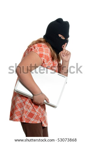 A young girl is stealing a laptop, isolated against a white background. - stock photo