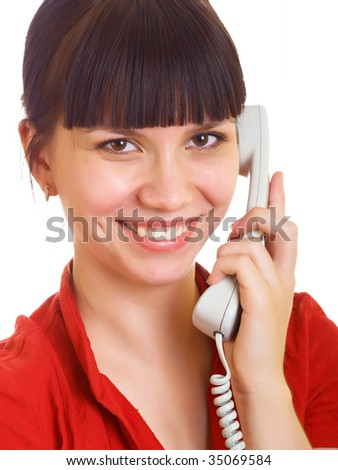 a young girl is talking to someone on the phone - stock photo