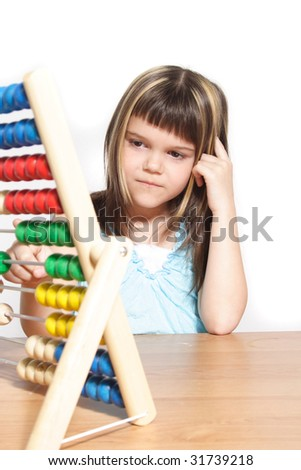 A young girl learning maths by using a sliding rule. All isolated on white background - stock photo