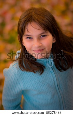 A young girl looking up at the viewer - stock photo