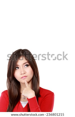 A young girl looking up to blank space. isolated over white background - stock photo