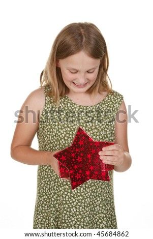 a young girl opens a present isolated on white