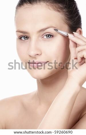 A young girl plucked eyebrows tweezers - stock photo