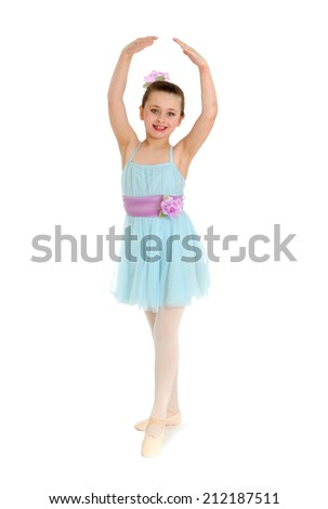 A young girl poses in ballet costume