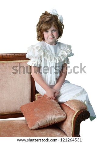 A young girl poses in her formal white dress isolated on white