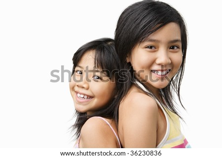A young girl posing with her little sister - stock photo