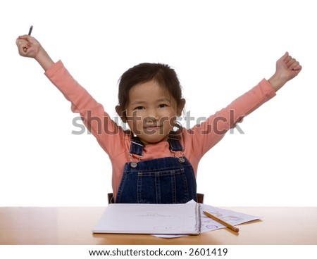 A young girl practices writing her letters - stock photo
