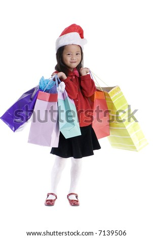 A young girl shopping for xmas presents. Childhood, Christmas.