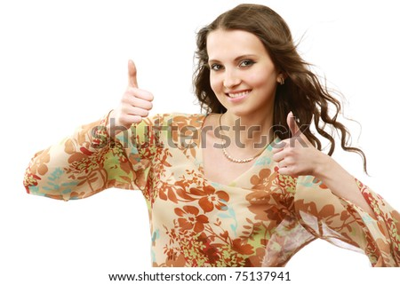 A young girl showing ok - stock photo