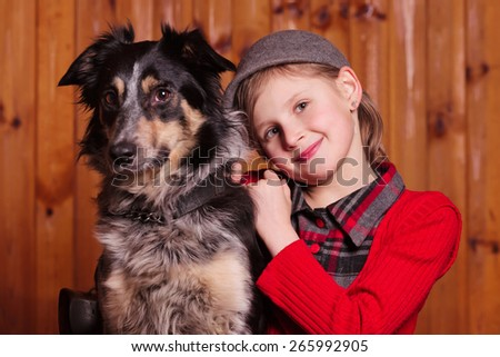 A young girl sits next to his friend dog breed Border Collie On the farm - stock photo