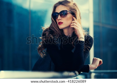 A young girl stands at the business centre and looks right. - stock photo