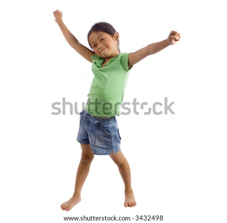 A young girl stands with her arms out....success. - stock photo